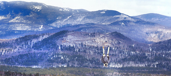 One of dozens of competitors practicing at Sunday River Thursday afternoon flies off one of the jumps at Sunday River as they prepare for Friday's qualifying round for a chance to compete in Saturday's finals of the Dumont Cup.