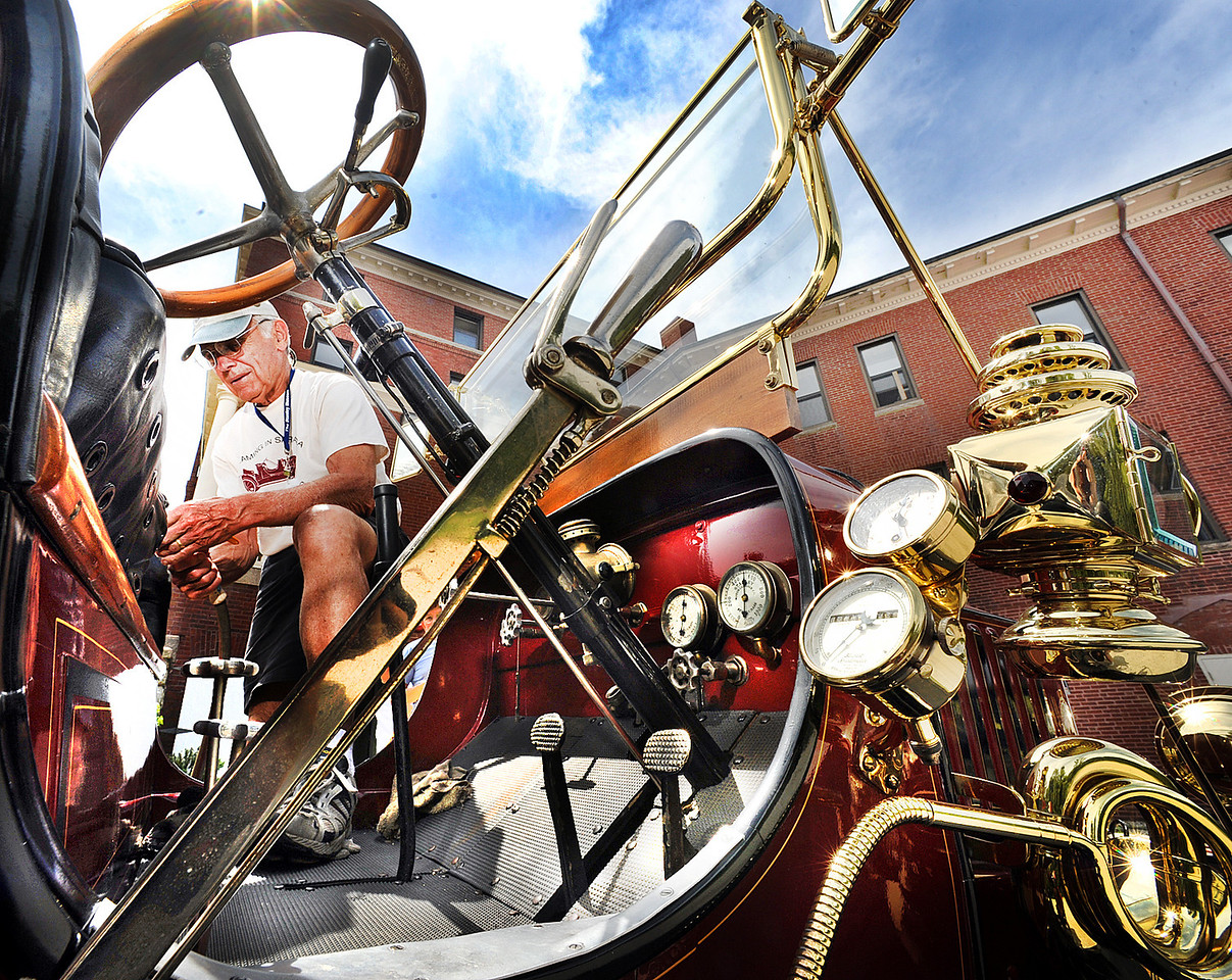 John Linderman of Glastonbury Connecticut fills up his 1910 Model 70 Stanley Steamer at Hebron Academy Tuesday afternoon.  Instead of gasoline, he used the school's hose to fill up the 35 gallon tank with water.  Linderman says he gets about one mile to the gallon of water.