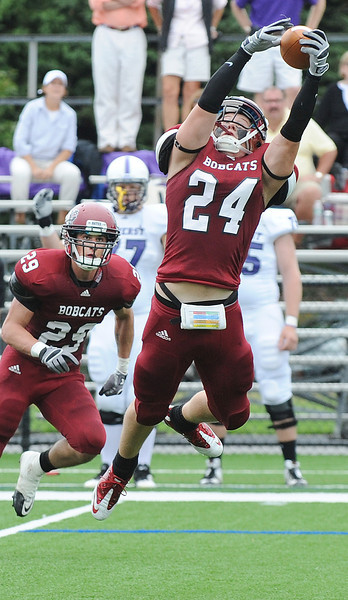 Bates College wide receiver Brett McAllister leaps for a pass but can't hang on as it fell incomplete during Saturday's season opener against Amherst at Garcelon Field in Lewiston where the Bobcats lost 20-7.