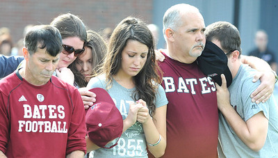 Some of the friends, family and faculty that were gathered on the Bates College football field Saturday afternoon comfort each other during a moment of silence for Troy Pappas, 18, of Eliot, who died Friday from a stairwell fall six days earlier.