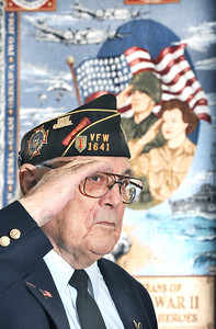 Al Richard, a WWII veteran, and member of the famed Big Red One, the 1st Infantry Division where he was attached to a 105mm howitzer squad and saw combat action in North Africa, France, Germany, Czechoslovakia and many other parts of Europe during the war.  He is at attention and giving a salute at VFW POST 1641 in Rumford earlier this week.