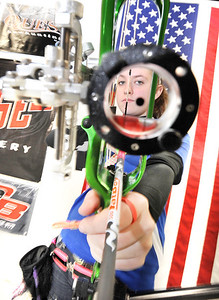 Callie Gallant of Poland, looks down her sights at Central Maine Archery in Auburn recently between ends.  She has recently been named to the US Archery Team as a 17 year old.