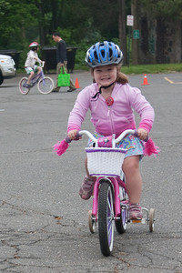 (1) Pslip Slug #: W 00019652; (2) Ridgewood, NJ; (3) 05/16/09; (4) Bike Rodeo and Safety Fair; (5) Hannah Clay, on the move, at the Ridgewood Bike Rodeo on 5/16/2009; (6) W.H. Grae for the Ridgewood News.