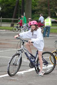 (1) Pslip Slug #: W 00019652; (2) Ridgewood, NJ; (3) 05/16/09; (4) Bike Rodeo and Safety Fair; (5) Chloe Rosichan prepares to ride in the Ridgewood Bike Rodeo and Safety Fair on 5/16/2009; (6) W.H. Grae for the Ridgewood News.
