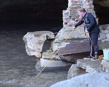 A firefighter at a river rescue attempt at East Falls on Oct. 10.  Steve Manheim / Chronicle