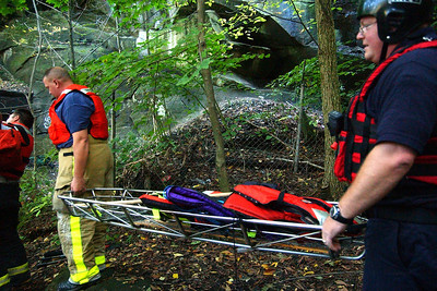 Firefighters bring a stretcher down to the base of East Falls during a river rescue attempt Oct. 10. Steve Manheim / Chronicle