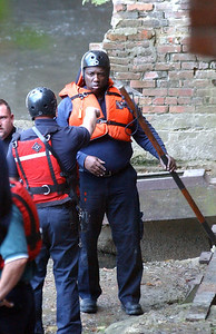 Firefighters in a river rescue attempt at East Falls on Oct. 10. Steve Manheim / Chronicle