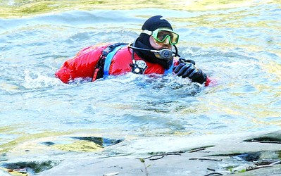 A diver comes up from Black River at East Falls in a river rescue attempt Oct. 10. Steve Manheim / Chronicle