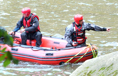 Firefighters in a river rescue attempt for a boy who fell off a cliff at East Falls on Oct. 10. Steve Manheim / Chronicle
