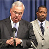Answering reporters in October, 2007 about the fatal shooting of 13 year-old Steven Odom, who was killed while on his way home from playing basketball. At right is Supt. Bruce Holloway, the head of Boston Police Dept. investigations.