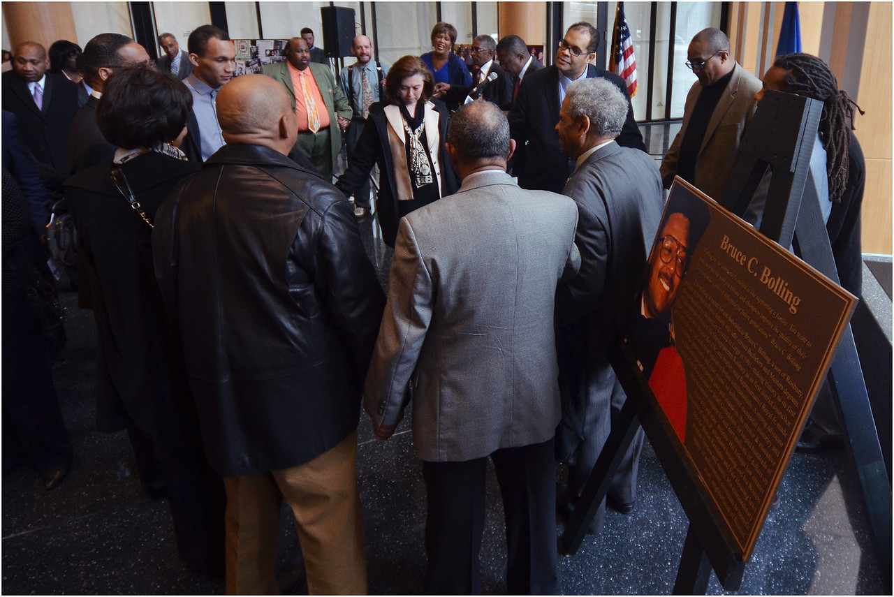 A joining of hands during benediction by Rev. Miniard Culpepper, Pastor of Pleasant Hill Baptist Church.