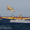 """Beaulieu sur mer  le 27/06/2007<br /> <br /> Sept """"Canadair"""" écopent dans la baie de Beaulieu sur mer ,St Jean cap Ferrat pour venir en aide aux pompiers qui luttent contre un départ de feu dans l'arrière-pays de Nice.<br /> <br /> ©Didier Baverel.com/Starface"""