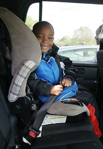 7OCT09  Jeremiah Eldemire, 5, loves being buckled up.  His mom Jani sometimes places treats in the cupholder in the armrest.   photo by Chuck Humel