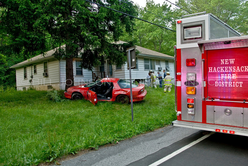 Car into residence after driver who was reported to be intoicated failed to negotiate a turn in the roadway. car struck the residence and then bounced off the same and then hit a tree.....