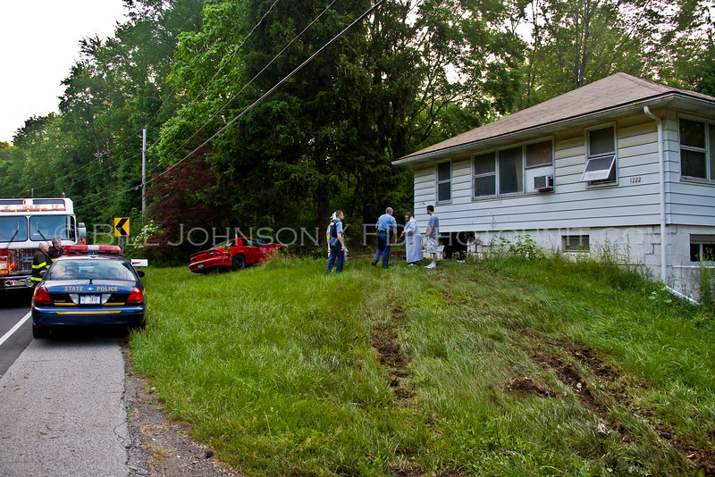 Car into residence after driver who was reported to be intoicated failed to negotiate a turn in the roadway. Car struck the residence, bounced