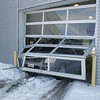 Car through dealership door :