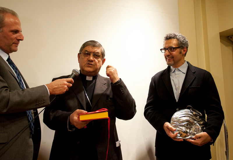 """Cardinal Sepe presents the """"DireNapoli"""" Award to John Turturro for his accomplishments in """"Telling Naples"""" to the world."""
