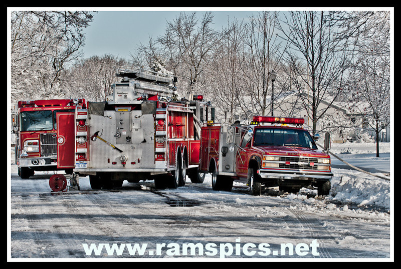 Emergency vehicles at the scene of a garage fire in Charlotte November 30, 2011.<br /> <br /> The comment tab (lower left) is activated...You can share your thoughts on a particular image or gallery. Your feedback helps me continually improve and to provide you... the best quality photographs possible><br /> <br /> Also, feel free to email me: Bob@ramspics.net which I monitor several times a day!<br /> Bob Monschein - Ramspics Photographer