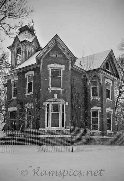 In the early 1900's this (red) brick home was considered one of the most impressive in Eaton County. The Dolson  house, as it's commmonlty refered to, was owned by a local industrialist who located his carriage (then automobile) factory in the county seat, Charlotte MI.<br /> The structure, long abandoned and near total collaspe, is on the corner of Horatio and Henry Streets.