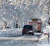 First snow storm of 2011 results in downed power and phone lines and tunnels of snow and ice. <br /> The Charlotte fire truck in the image is leaving the scene of a garage fire on the east side of town.
