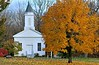 The first courthouse in Eaton county, now located in Bennett Park near the Battle Creek River.<br /> This image of the courthouse with peak fall colors, is the cover photo on the 2011 Eaton County Directory.