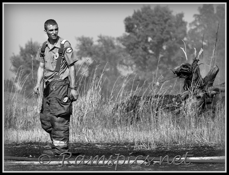 Captain,Tyger Fullerton a third generation firefighter with the Charlotte Fire Department (and Rural Association) surveys the scene of a wheat / grass fire outside of Charlotte.<br /> <br /> *** any questions or suggestions email: Bob@ramspics.net or use the comment tab, below left and let me know what you think! ***