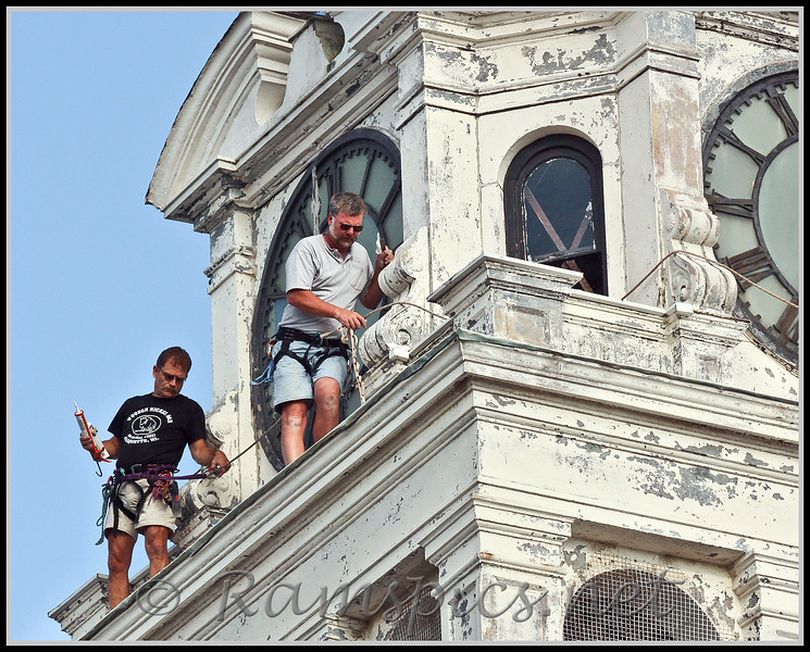 Repairs high up on the clock tower of the 1885 courthouse, in Charlotte Michigan.