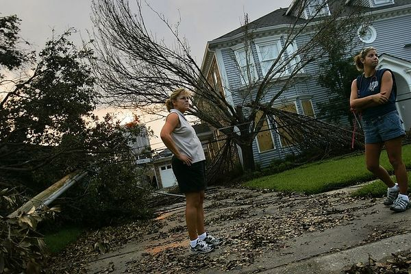 9/5/05 -- Jefferson Parish, Louisiana -- Cyndi Shenk, 51, left, cq, and her daughter Lauren Downey, 24, cq, stand in front of Shenk's Hessmer Avenue home in Metairie, which is in Jefferson, Louisiana. The Shenk's home sustained little damage, and Dr. and Mrs. Shenk plan to stay in their other home in Florida while repairs are underway. Thousands of residents streamed back to Jefferson Parish starting at dawn on Monday morning, September 5, 2005 to encounter a range of property losses. Some found flooded and looted properties and businesses, some encountered total loss, other were pleasantly surprised at how well their properties weathered Hurricane Katrina. Cars were backed up for miles leading into Jefferson Parish on Airline Highway. Many  of the vehicles were driven by passengers who slept in their cars overnight to secure a spot in line. People were required to show proof of residence in order to pass police check points. Boston Globe Photo - reproduction requires explicit written permission from the Boston Globe. Story by Stephen Smith, Boston Globe Staff.