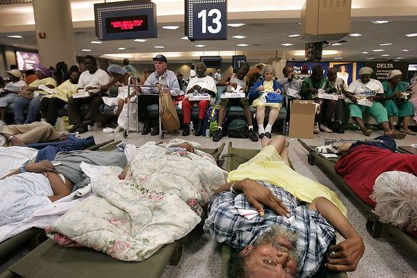 9/2/05 -- New Orleans, Louisiana -- The Louis Armstrong New Orleans Airport became a large-scale repository for those evacuated from hurricane-destroyed areas. Evacuees were airlifted from various locations, including hospitals and nursing homes, to the airport, where they were triaged and sorted according to immediate needs. Some patients were stabilized and given there medications, but the medical personel were overwhelmed by the volume. Next to one of the patient dispatch areas (which was fomerly a traveler lounge area as part of the airport) was a temporary morgue, where one medical worker said that personel would take DNA samples from the bodies before embalming them and placing them in refrigerated trucks on the premises. This is not confimed. <br /> Boston Globe Photo - reproduction requires explicit written permission from the Boston Globe