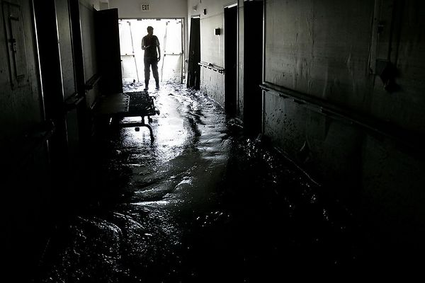 9/14/05 -- Violet, LA -- St. Bernard Parish -- St. Rita's Nursing Home -- <br /> Thirty-four people died when flood waters from Hurricane Katrina innundated the St. Rita's Nursing Home in Violet, LA. The owners, Salvador A. Mangano and Mable B. Mangano, have been charged with 34 counts of negilgent homicide by the Louisiana attorney general for failing to evacuate the patients. Authorities estimate that 140 mile-per-hour winds raked the town in St. Bernard Parish and that a 20-foot storm surge swept the town. Boston Globe Photo - reproduction requires explicit written permission from the Boston Globe. Story by Stephen Smith, Globe Staff