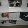Anna hiding on shelf - smart little whippersnapper