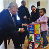 Danielle Johnson, a 5 year-old neighborhood resident,  receives her gift from Mayor Menino during the distribution at Ronan Memorial Hall, home of the Catholic Charities Teen Center at St. Peter's.