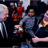 A three year-old neighborhood customer, Cheyanne Wilson, assisted by stylist Jessica Rodriguez, shakes hands with Mayor Thomas Menino during his visit to Fwresh Salon & Spa Barbershop on Bowdoin Street.