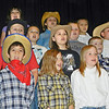 "Third-graders at Tony Goetz Elementary School including, front row, from left, Kenneth Acevedo, Alexis DeLay and Sway O'Laughlin put a western swing to their holiday program with ""Christmas at the O.K. Corral, A Rootin' Tootin' Musical."" The school's music program also featured fifth-and sixth-graders performing on recorders and bells."