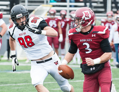 Wesleyan's Sam Green forces Bates quarterback Brendan Costa out of the pocket and to the sidelines where he had to throw the ball away during Saturday's football game in Lewiston. (Russ Dillingham/Sun Journal)