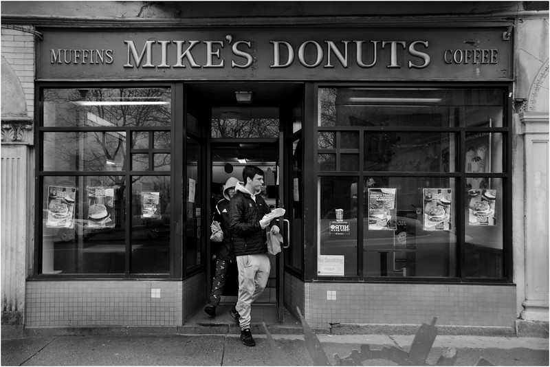 Mike's Donuts and take-out customers. Tremont Street, Mission Hill. March 17, 2020.