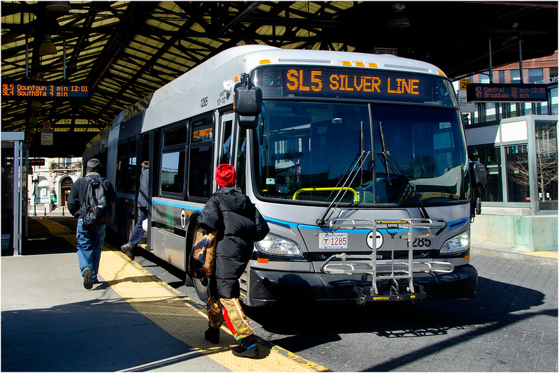 Boarding Silver Line bus through side door at Nubian Square, Roxbury. March 22, 2020.