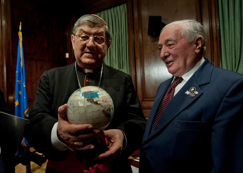 "(L-R): Cardinal Sepe receives a gift from Pasquale Carucci, President of the Caggianesi D'America during a visit at the Italian Cultural Institute on 686 Park Avenue. Presentation of the ""Dire Napoli"" initiative. <br /> New York, January, 18th, 2011"