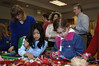 """In the foreground, Anna Tun Naing, age 7, from Serene Lake and Nadine Eskandar, age 6,of Mukilteo, work on their """"Crazy Hair"""" creations. Mayor Joe Marine is in the background."""