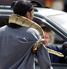 After being couped up all winter long, Ronald Coleman brought his pet Red Tail Boa,  Caesar out to enjoy the sun, turning a few heads as he made his way around the streets of Lewiston.  This motorist  heading down Oak Street pulled over to see if it was really real.