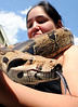 It is a sure sign of Spring when Ron Coleman of Howard Street in Lewiston is seen walking around Lewiston with his 7 foot red tailed boa.  It turns the heads of most people and he often gets requests to hold it.  When April Aguilar of Lewiston, above, noticed Coleman walking down the street with the 10 year old pet, she asked if she could hold Ceasar for a friend to take her photo with him.