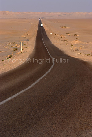 The desert landscape on the flat straight road between Layoon and Dakhla