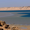 The tide flowing in and out coloring the water, Dakhla lagoon, Morocoo.