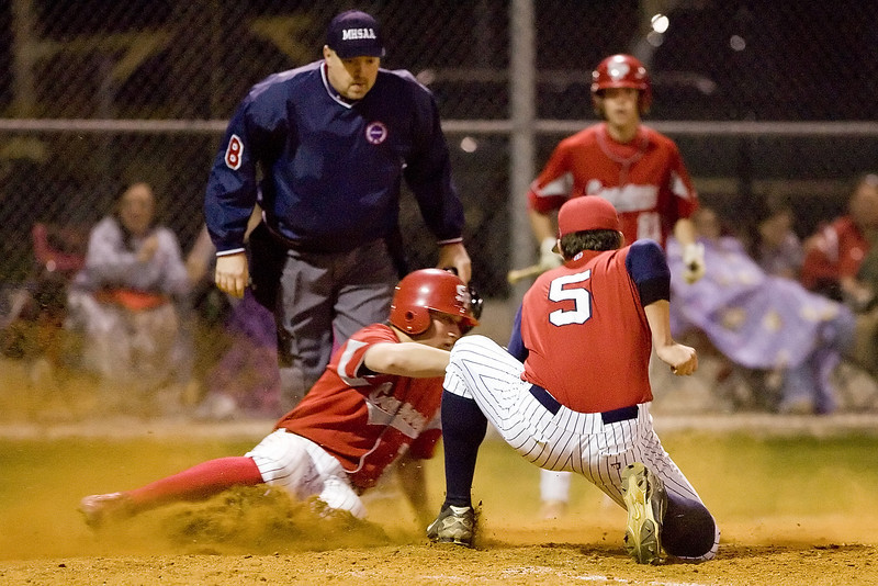 South Pontotoc's Adam Roye slides home safe ahead of the tag attempt of Hunter Richardson