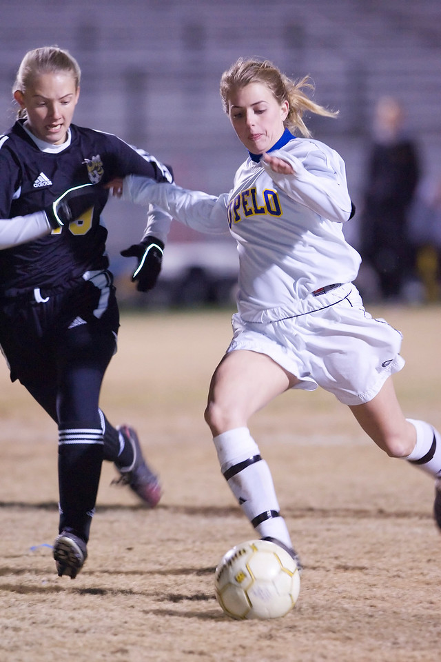 Tupelo's Aleigha Bondurant drives past Starkville's Mackenzie Thomlinson for the Lady Waves winning goal