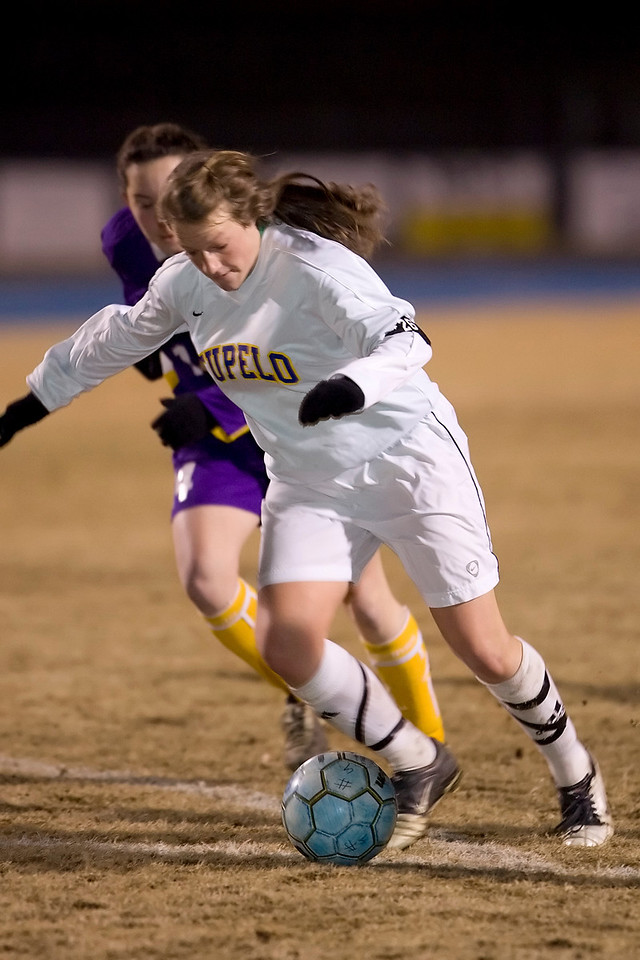Tupelo's Meghan Brown breaks free from a Desoto Central defender for one of two goals Wednesday night.