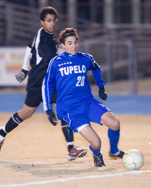 Tupelo's Patrick McPherson scores in the first overtime period