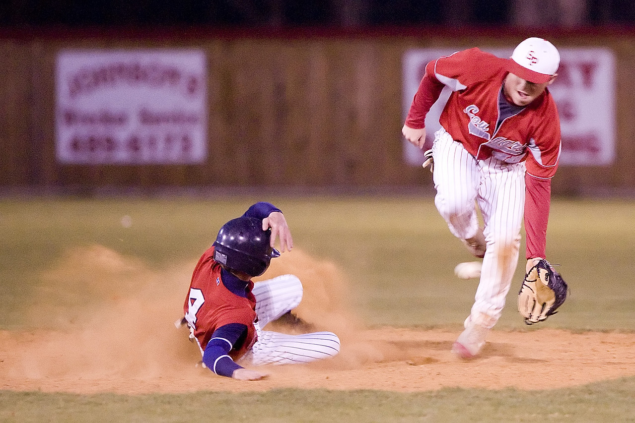 Nettleton's Colby Chaney slides safely into second ahead of David Bowen