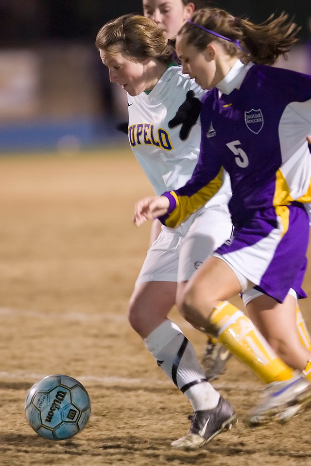 Meghan Brown breaks free from Desoto Centrals's Delauncey Fortin for one of her two goals Wednesday night.