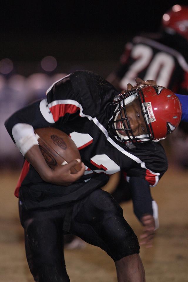 Corinth #12 Zeririck Payne tries to avoid an arm tackle